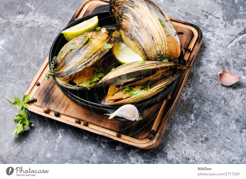 Delicious seafood mussels dish gourmet cooked shellfish parsley fresh cuisine boiled lemon mollusk eating pan steamed frying pan french herb table rustic tasty