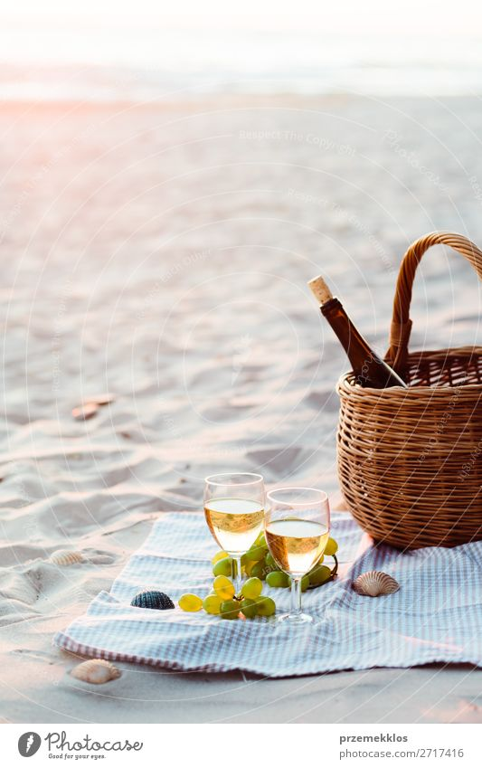 Two wine glasses, grapes, wicker basket on beach Fruit Picnic Beverage Alcoholic drinks Wine Champagne Bottle Champagne glass Lifestyle Beautiful Relaxation