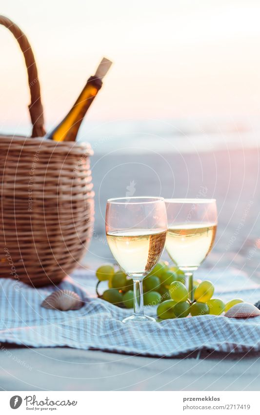 Two wine glasses, grapes, wicker basket on beach Fruit Beverage Alcoholic drinks Wine Champagne Bottle Champagne glass Lifestyle Beautiful Relaxation