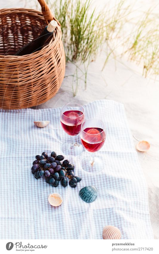 Two wine glasses, grapes, wicker basket on beach Food Fruit Picnic Beverage Alcoholic drinks Wine Champagne Bottle Champagne glass Beautiful Relaxation