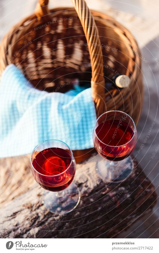 Two wine glasses, grapes, wicker basket on beach Beverage Alcoholic drinks Wine Champagne Bottle Champagne glass Beautiful Relaxation Vacation & Travel Summer