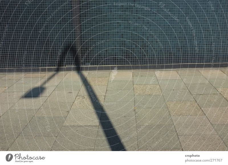 I'm a little bent. Deserted Places Manmade structures Wall (barrier) Wall (building) Bright Blue Calm Sidewalk Shadow Street lighting Colour photo Exterior shot