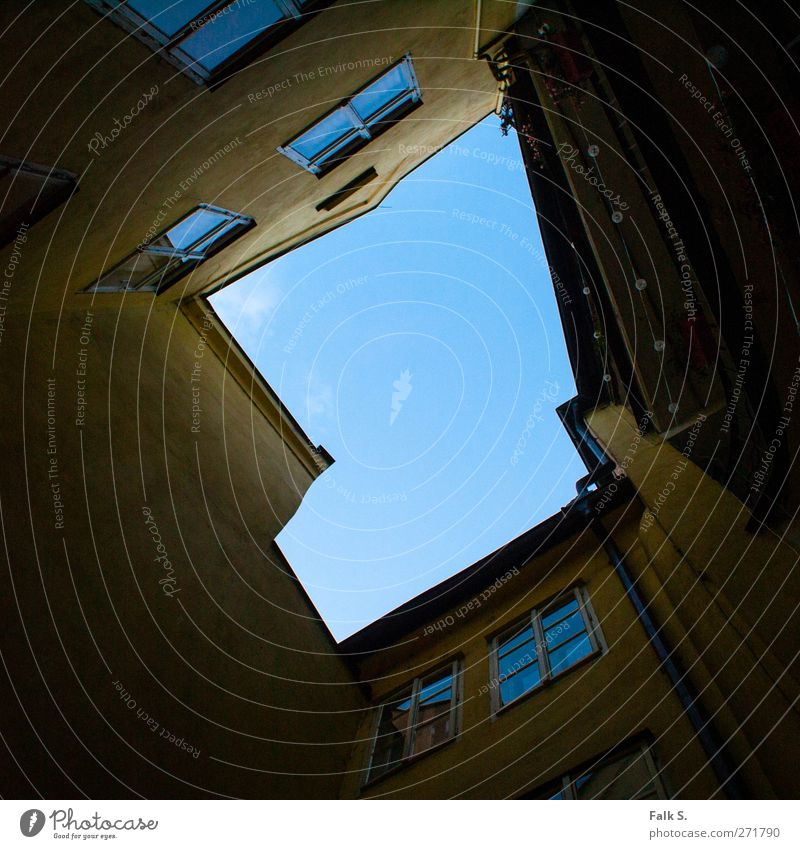 upward House (Residential Structure) Air Sky Cloudless sky Beautiful weather Town Wall (barrier) Wall (building) Facade Balcony Window Eaves Interior courtyard