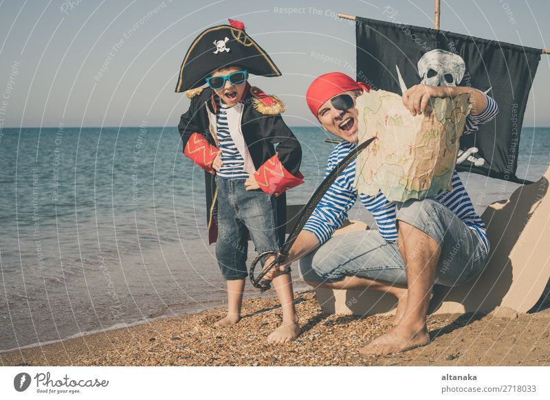 Father and son playing on the beach at the day time. Lifestyle Joy Happy Relaxation Leisure and hobbies Playing Vacation & Travel Trip Adventure Freedom Cruise