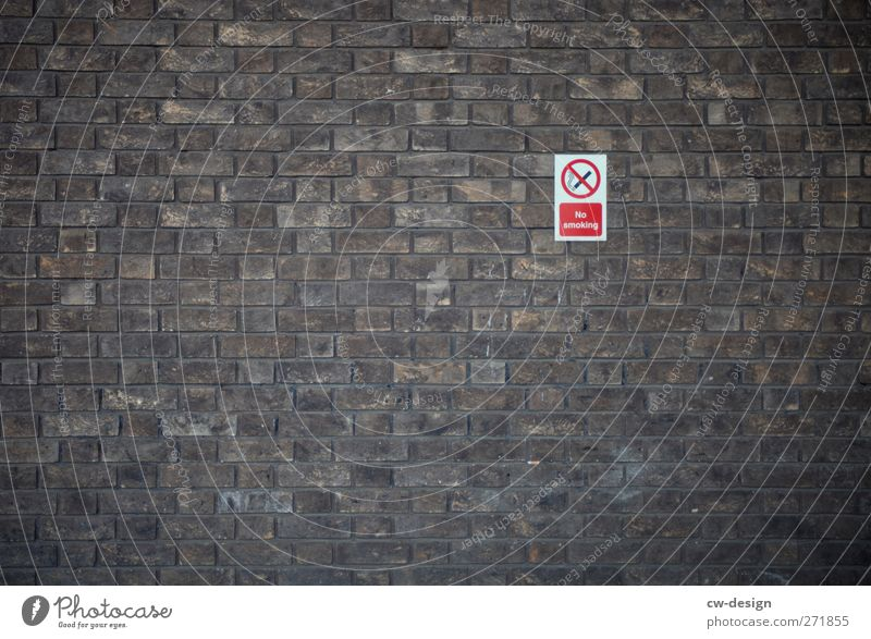 Don't get wrapped up! Deserted Architecture Wall (barrier) Wall (building) Facade Sign Characters Signs and labeling Signage Warning sign Sustainability Brown