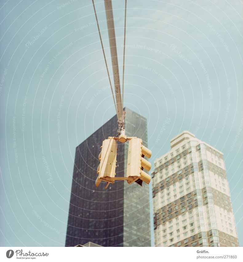 New York City Sky Town Skyline High-rise Architecture Transport Street Traffic light Blue Yellow Gray Haste Colour photo Exterior shot Deserted Copy Space top