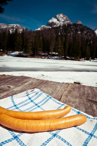 2 Viennese in Tyrol Food Sausage Nutrition Lunch Picnic Snow Mountain Table Environment Nature Landscape Sky Beautiful weather Wood Lie Simple Delicious Natural