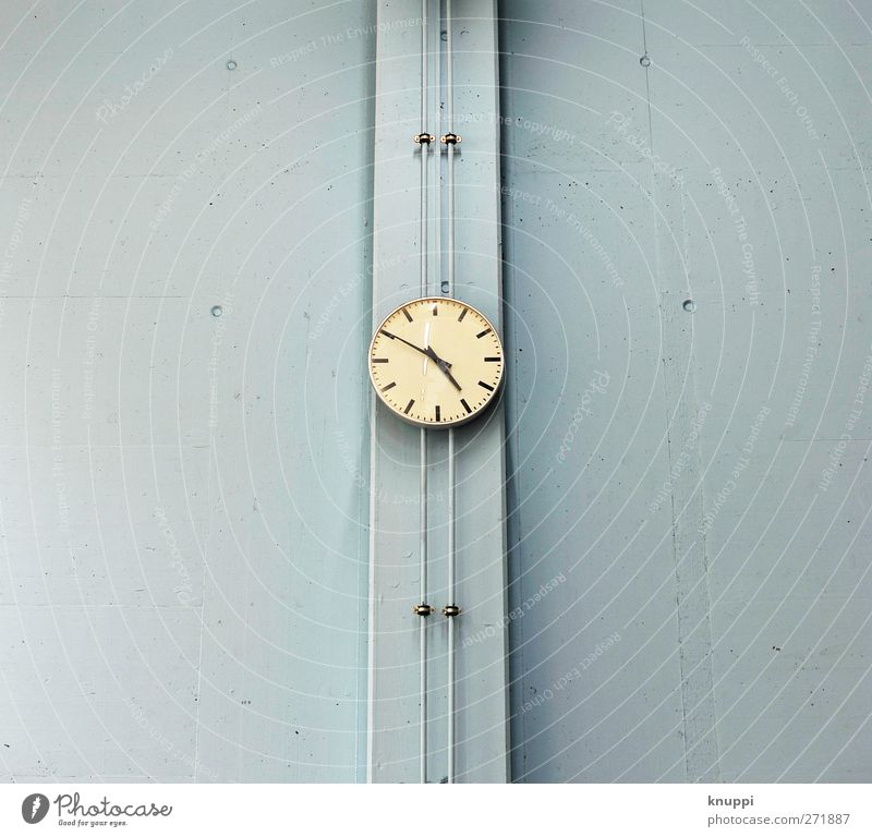 time Leisure and hobbies Time Blue Wall (building) Conduit Bright Light blue Beige Hollow Concrete Concrete wall Hall Clock face Timetable Clock hand Wall clock