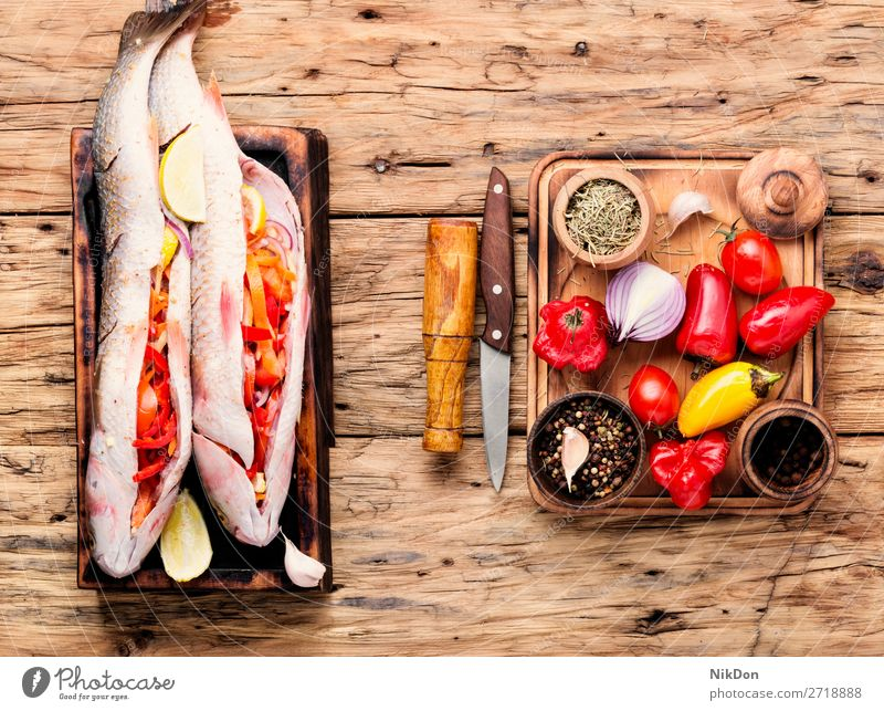 Fresh uncooked fish food stuffed fish whole fish seafood fresh healthy ingredient lemon cuisine pelengas preparation table spice diet raw pepper vegetable