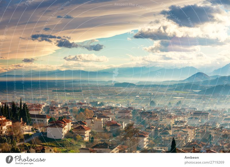 Greek town evening panorama with red roof houses, valley and mountains in the background, Kalambaka, Thessaly, Greece Kalabaka autumn beautiful building church