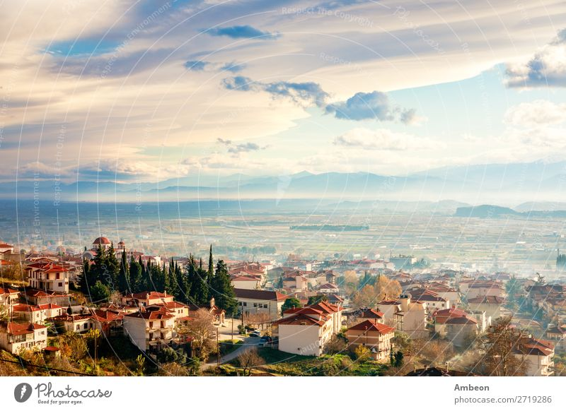Greek town sunset panorama with red roof houses, valley and mountains in the background, Kalambaka, Thessaly, Greece Kalabaka autumn beautiful building church