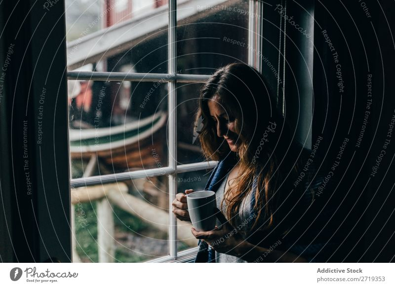 Woman with mug near window Coffee Window Morning Human being Mug Tea Drinking Beautiful pretty Attractive Relaxation Rest Leisure and hobbies Beverage enjoying