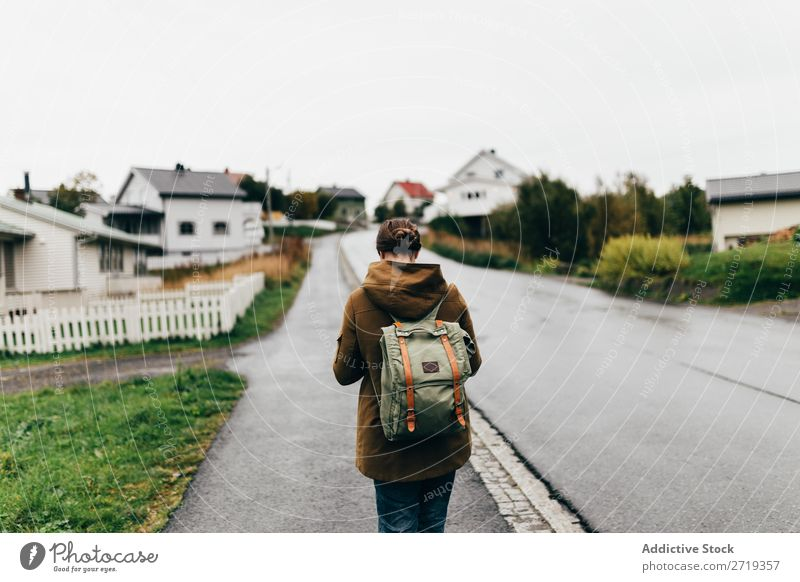 Woman on village street Village Street Vacation & Travel Tourism Tourist Walking Human being traveler Backpack Rural Rustic House (Residential Structure)