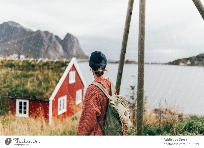 Woman looking at mountain lake Lake Mountain enjoying House (Residential Structure) Nature Landscape breathtaking Water Sky Vantage point Vacation & Travel