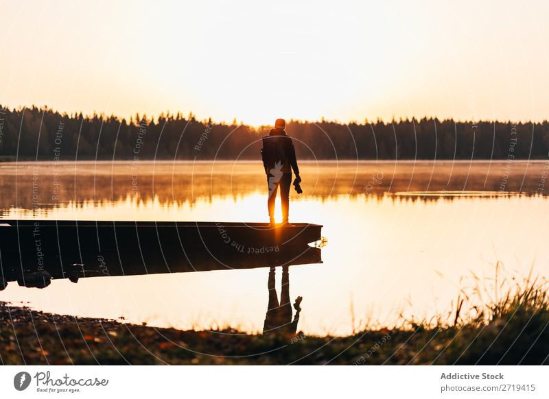 Person on lakeside in morning haze traveler Lake Morning Calm Reflection tranquil Multicoloured Freedom Landscape scenery Vacation & Travel Nature Peaceful
