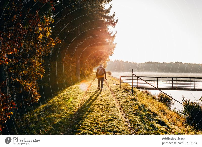 Backpacker in morning light on lakeside Lake Calm Morning Multicoloured Landscape Gold Coast Freedom