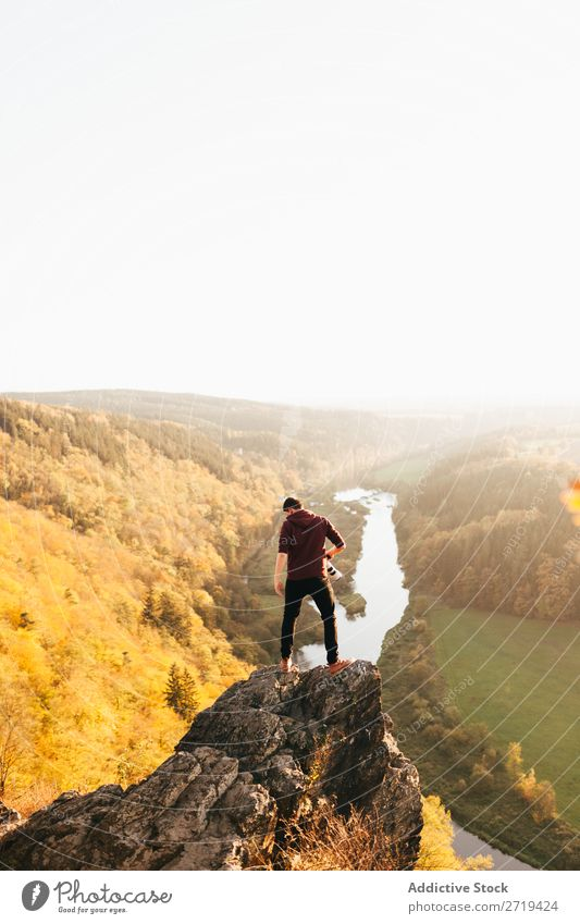 Man on edge of cliff on nature Valley Autumn Height Cliff Mountain Vantage point Vacation & Travel Nature