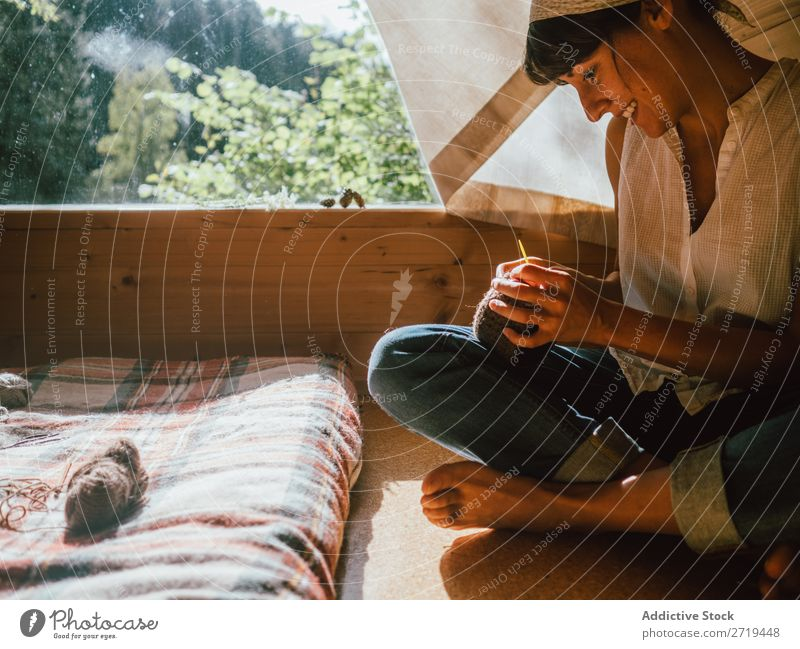 Woman knitting in sunlight Knit House (Residential Structure) Nature Home Relaxation Contentment woolen Comfortable Sunlight Safety (feeling of) Wood Summer