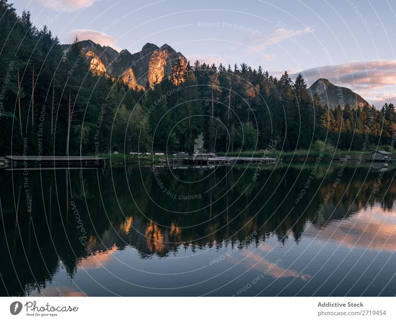 Dock on lake in mountains in Dolomites, Italy Mountain Lake Landscape Jetty Building Calm Reflection