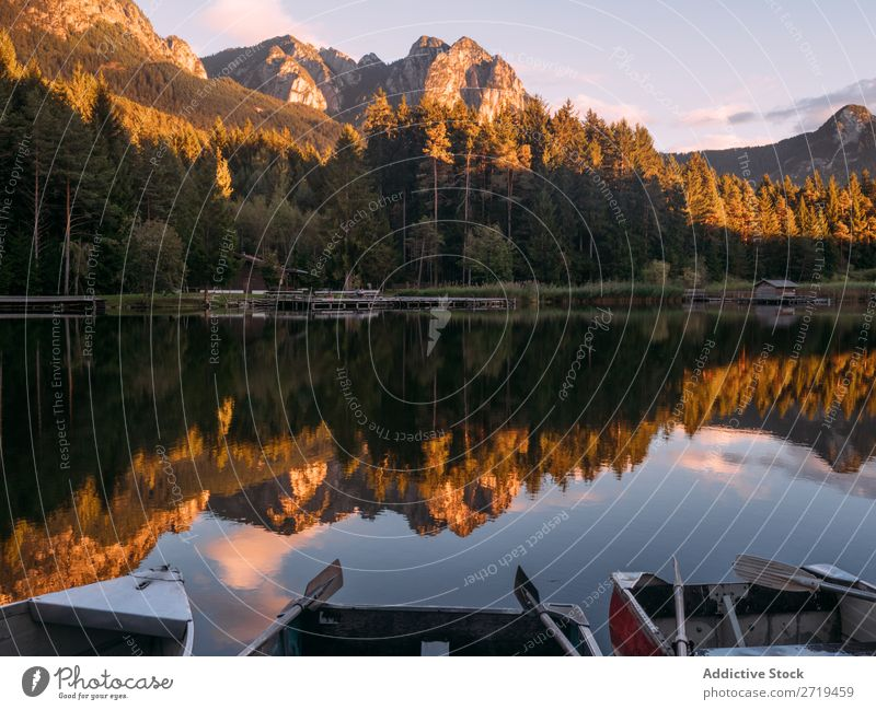 Mirror surface of lake in mountains in Dolomites, Italy Mountain Lake Serene Calm Water Building Landscape Dock