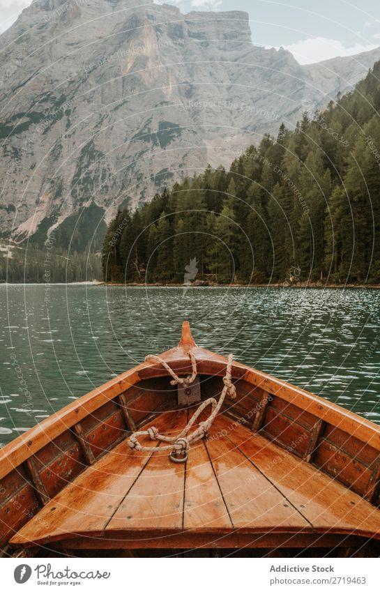 Crop wooden boat on lake Watercraft Lake Mountain Forest Beak Evergreen coniferous Exterior shot Panorama (Format) Landscape scenery tranquil Serene Crops