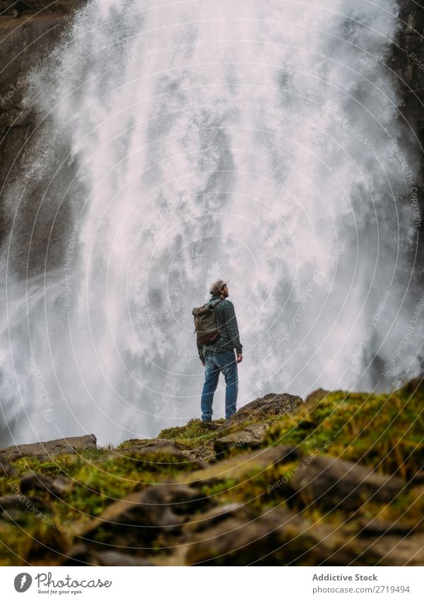 Man on background of waterfall Waterfall Tourist Vacation & Travel Nature Adventure Green Natural Destination trekking Landscape cascade Powerful Anger Stream