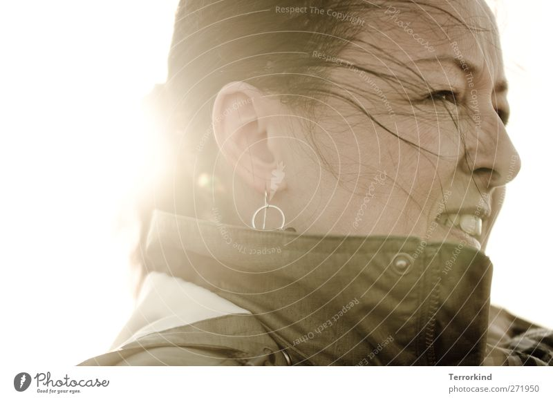 Hiddensee | back.wind Human being Strong fortified tailwind Force Feminine Hair and hairstyles Blow Face Mouth Teeth Nose Back-light Sun Sunlight Sunbeam