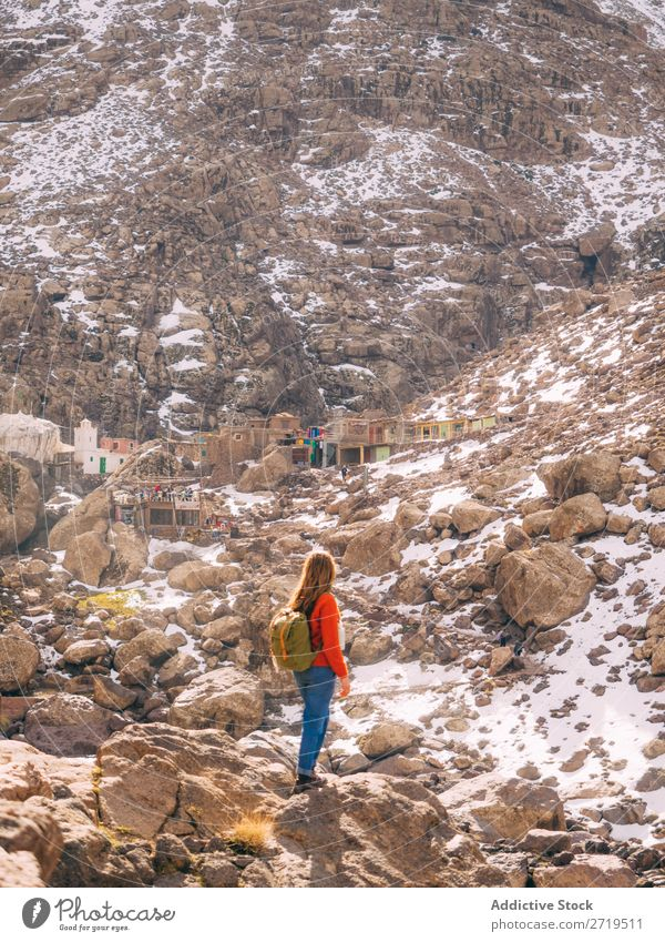 Female backpacker in mountains exploring settlement Woman Tourist Mountain Vacation & Travel Village Tourism Culture Rock Monument traveler Destination Old