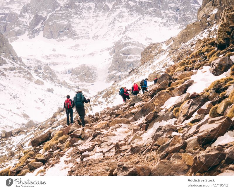 Tourist walking in mountains Human being Mountain Lanes & trails trekking Tourism Winter Landscape Rock Hiking Snow Walking Nature Vacation & Travel