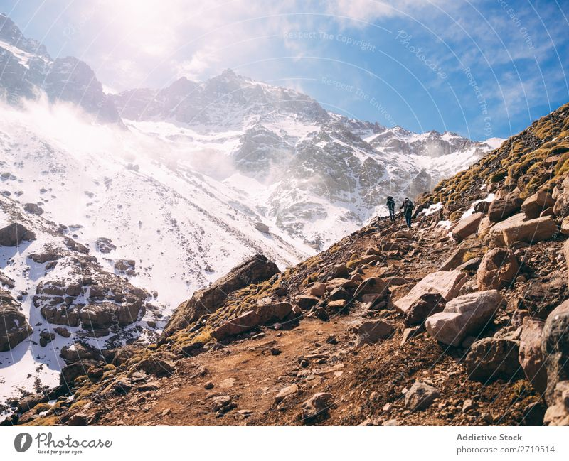 Tourist exploring mountains Human being Mountain Tourism Winter Landscape Rock trekking Hiking Snow Lanes & trails Walking Vacation & Travel Nature