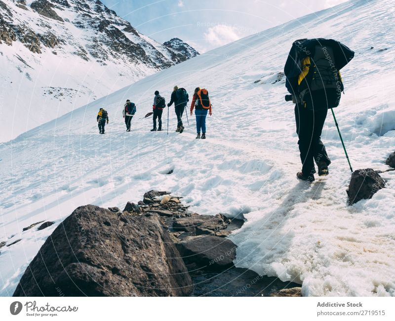 People on snowy downhill Human being Mountain Tourism Winter Landscape Rock trekking Hiking Snow Lanes & trails Walking Vacation & Travel Nature