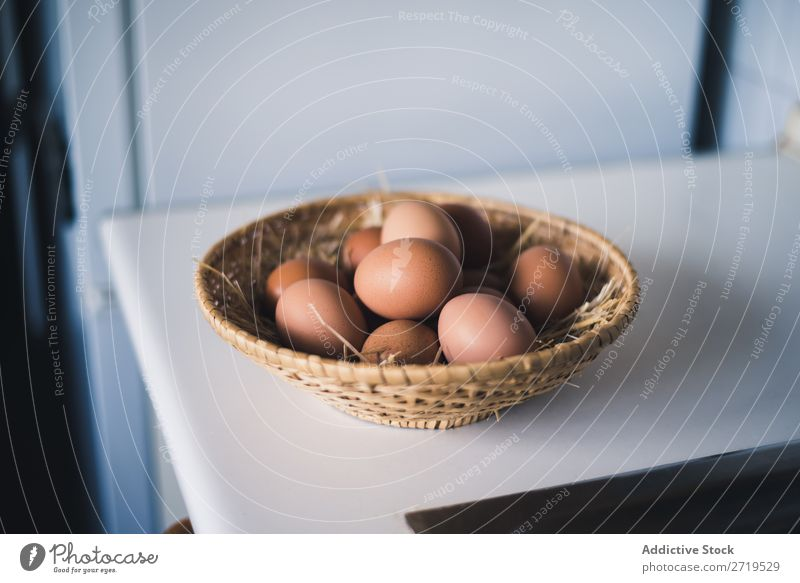 Straw bowl with chicken eggs Egg Bowl Chicken whole Basket Food Ingredients Cooking Raw Fresh Protein Natural Organic Brown Breakfast Easter Eggshell Healthy