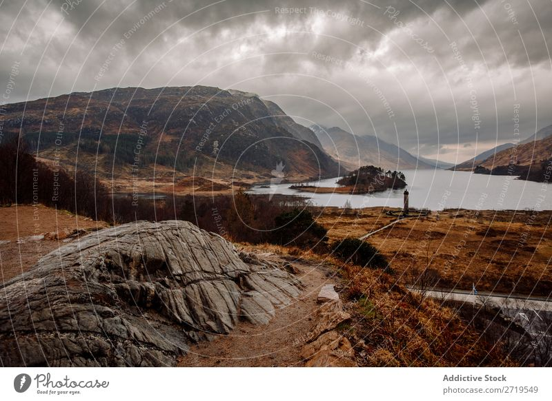 Coast of mountain lake Rock Lake Hill Mountain Landscape Nature Water Natural Stone Beautiful Fog Clouds Scotland Grass Vacation & Travel Cliff Vantage point