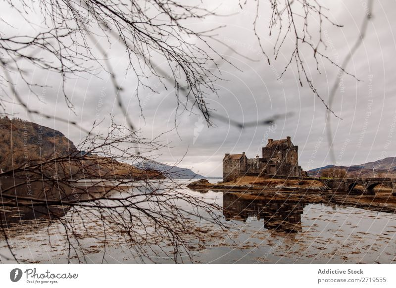 Historic castle at lake Castle Old Coast Rock Lake Hill Mountain Landscape Nature Water Natural mansion big Stone Beautiful Clouds Scotland Grass