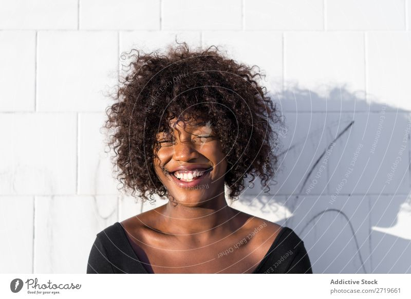 Ethnic woman at white wall Woman pretty Beautiful Youth (Young adults) Portrait photograph Human being Attractive Curly Black Face Nationalities and ethnicity
