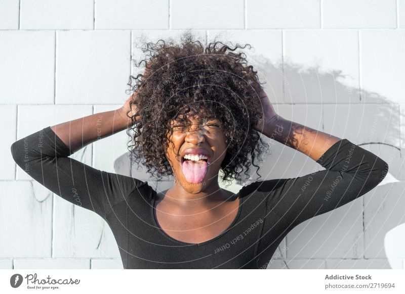 Ethnic woman making faces Woman pretty Beautiful Youth (Young adults) Portrait photograph grimacing Human being Attractive Curly Black Face