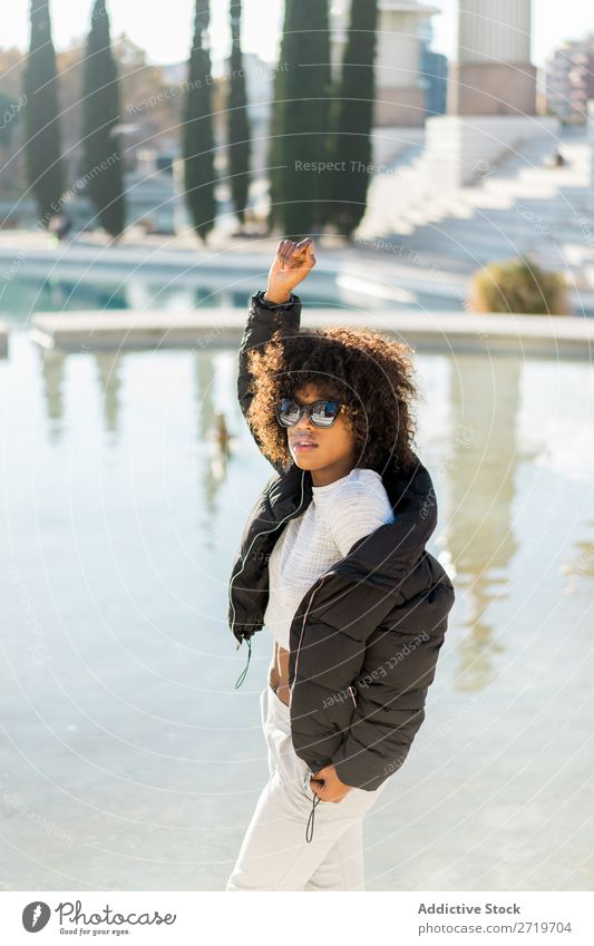 Stylish woman at city pond Woman Ethnic pretty Beautiful Youth (Young adults) Sunglasses hand up Pond Park Cool (slang) City Town Style Portrait photograph