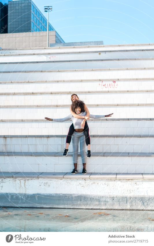 Woman carrying her friend behind her back Athletic Together Youth (Young adults) Cheerful Smiling Steps Jump
