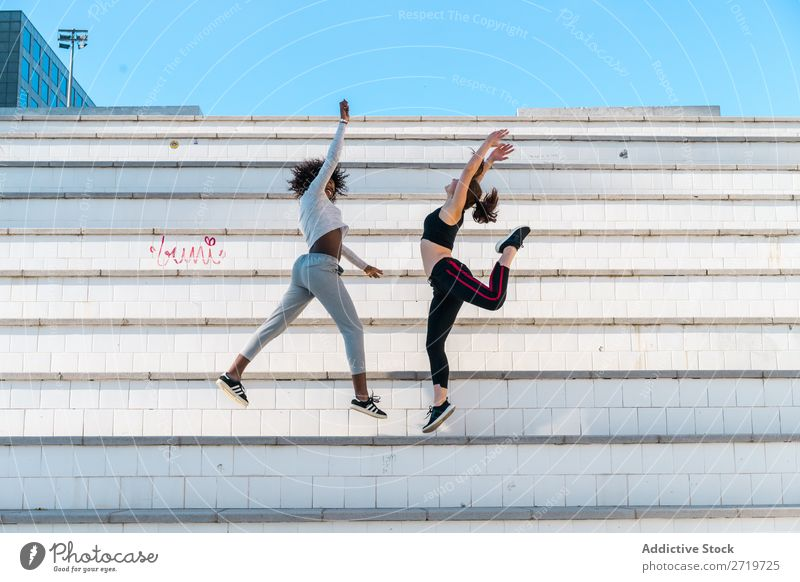 Pretty fit women jumping together Woman Athletic Together Youth (Young adults) Cheerful Smiling Steps Jump