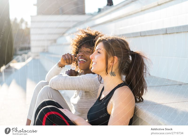 Happy friends sitting on steps Woman pretty Beautiful Youth (Young adults) Sit Steps Cool (slang) City Town Style Portrait photograph Human being Attractive