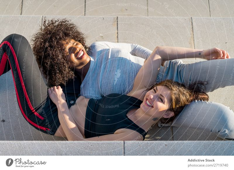Happy friends sitting on steps Woman pretty Beautiful Youth (Young adults) Sit Steps Looking into the camera Cool (slang) City Town Style Portrait photograph