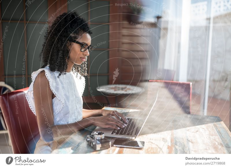 woman working on laptop Woman Business Ethnic Communication Computer Smiling Cellphone Curly hair PDA Work and employment Technology Study Copy Space