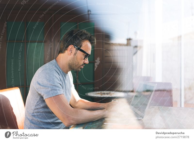 Man working on laptop Business Communication Computer Cellphone PDA Work and employment Technology Study Copy Space Businessman Profile Modern Easygoing Office