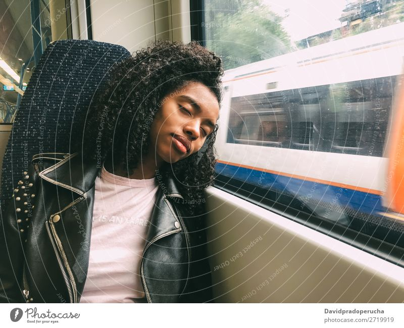 Tired black woman sleeping on the train Woman Transport Commute asleep Fatigue Railroad Window Far-off places sleepy Sleep Black Dream Lean wagon Lifestyle Trip