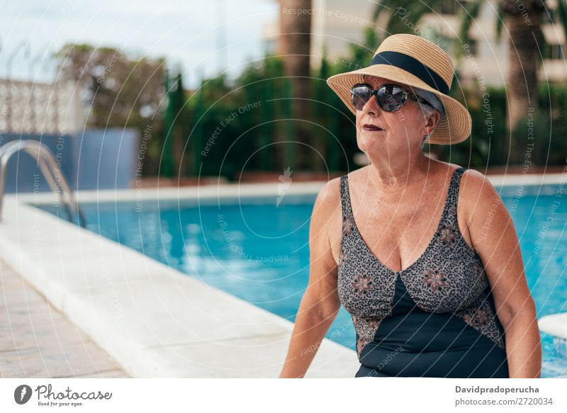 Senior old woman grey hair sitting by the swimming pool Woman Vacation & Travel Old Swimming pool Senior citizen Leisure and hobbies Wellness Caucasian Natural