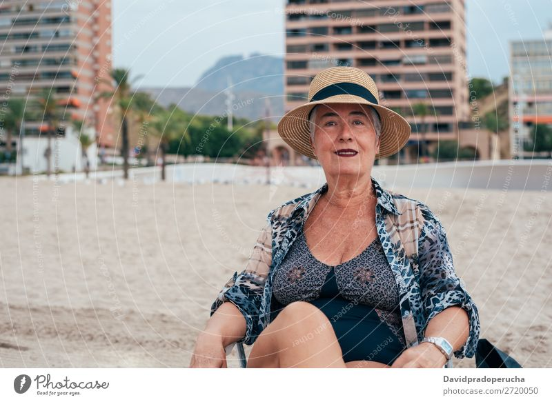Elderly woman on the beach wearing a straw hat Woman Vacation & Travel Old Beach Senior citizen Leisure and hobbies Caucasian Natural Happy grey hair To enjoy