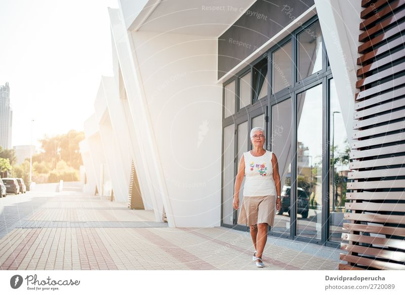 Elderly woman walking on the street Woman grey hair Old Beauty Photography retired Human being Senior citizen Relaxation Walking Street Cute Attractive