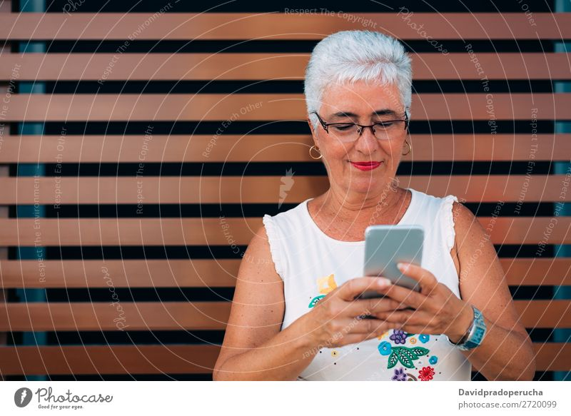 Happy elderly woman on the mobile phone Woman grey hair Old Cellphone PDA Technology Portrait photograph Beauty Photography Communication Cheerful retired