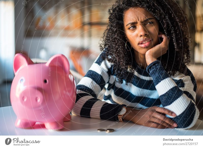 Thoughtful confused black woman with piggy bank Woman Money box Considerate debt Crisis Expression Irritation mistake Sadness Budget worried disappointed