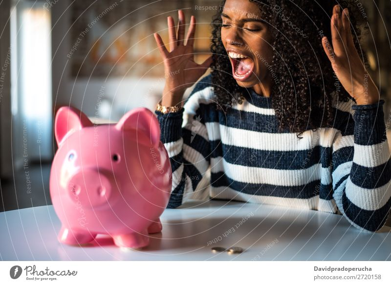 Black unhappy woman angry at piggy bank Woman Money box savings Crisis Sadness Anger Stress Emotions annoyed Scream trouble Expression frustrated Problem